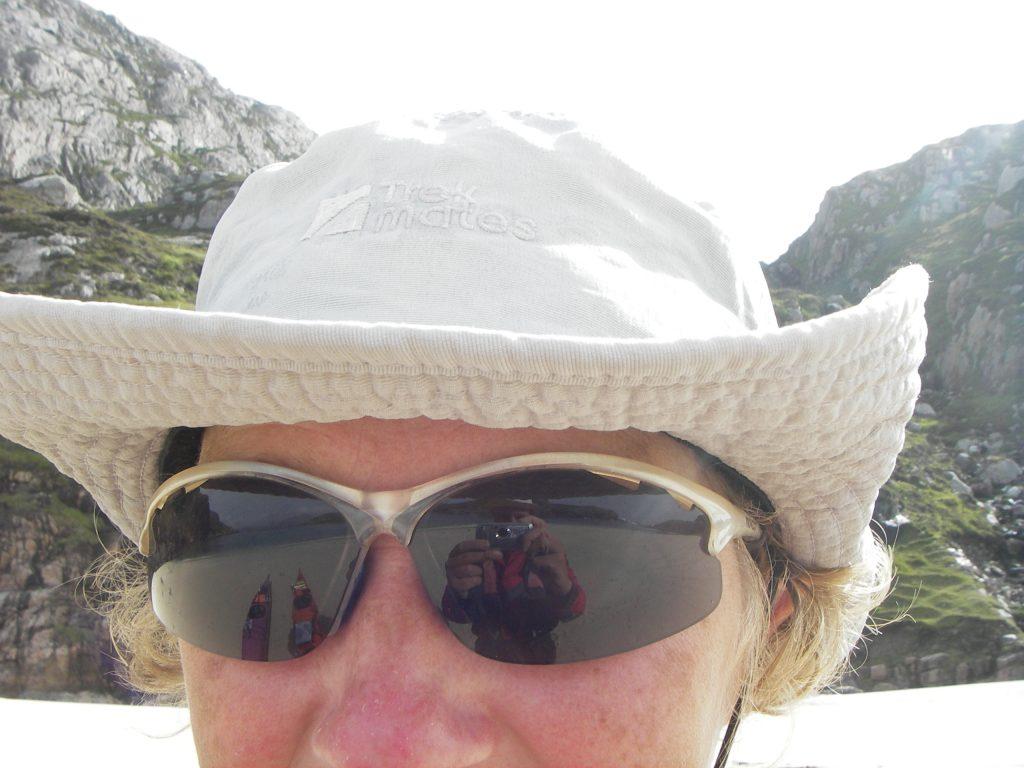 Refelction of fotographer in sunglassen of Charlotte gannet