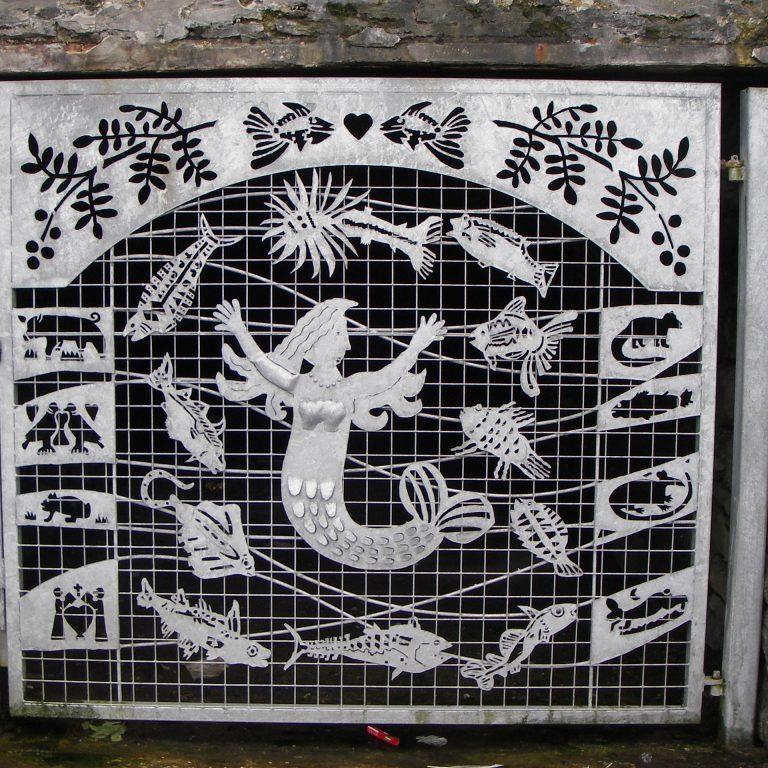 Mermaid in steel door in Wick, Scotland.